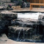 Custom hot tub with spill-over into small pool.